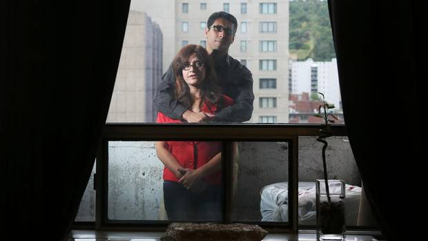 Fahimeh Sinai and Peyman Rajabian as they prepare to leave their Montreal apartment. Christinne Muschi/Globe and Mail